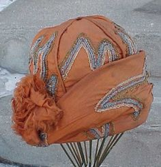 1920s Burnt Orange, Tan, and Blue Embroidered Silk Cloche Flapper Hat.