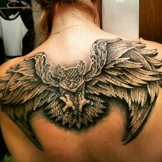 Owl tattoo on upper back.