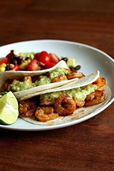 shrimp tacos by Elly Says Opa, Not quite vegetarian, but pescatarian. Will have to make for the seafood eaters when I make vegie tacos for everyone else.
