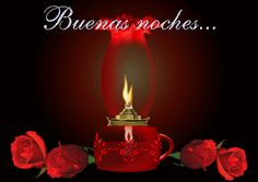 Ver imagen de una lámpara prendida entre lindas rosas de color rojo con brillo y movimiento junto a la frase: Buenas Noches