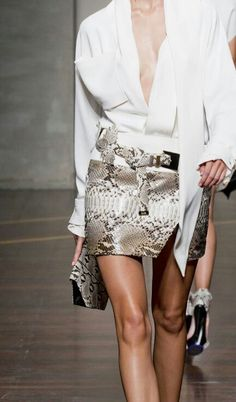 Very cool look - a classic white shirt gets an edgy make-over, and then paired with a snakeskin mini