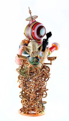 "Artist Snic Barnes' ""Latchkey Day Dreams."" 14 x 6 x 6 in. Flameworked glass and Copper."