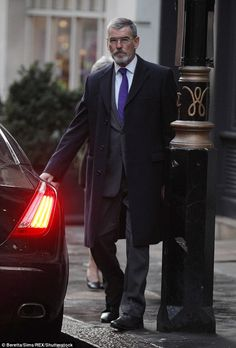 Rolling: Pierce was seen leaving a London location and jumping into a waiting car in his s...