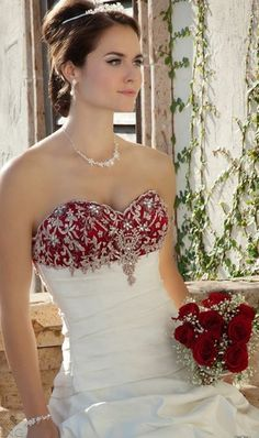 Strapless wedding dress. White wedding dress with burgundy trim. Burgundy red and white wedding dess. White and burgandy red wedding dress