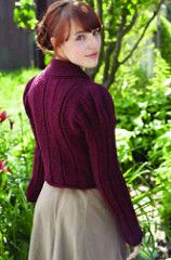This spencer jacket features herringbone stitches and slightly puffy sleeves, stylistic of Regency era fashion. Originally designed as a mockery of the extreme fashions of the Regency period, the Spencer jacket became a signature piece of the time. Oddly flattering, simple to wear, and fun to knit up, this jacket will become a perennial favorite in many seasons.