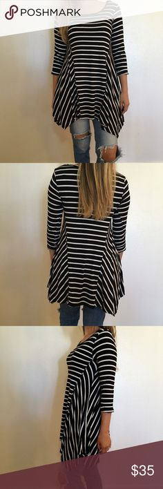 """3/4 Sleeve Striped Asymmetrical Tunic 3/4 Sleeve Striped Asymmetrical Tunic. Brand new. Never worn. Available in S-M-L. 95% rayon 5% spandex. Model is wearing a small for reference.  LADIES SIZE (MISSY) *** 3/4 CUFFED SLEEVE ROUND NECK STRIPE ASYMMETRICAL TOP BUST: S-16 1/4"""" / M-17 1/4"""" / L-18 1/14"""" WAIST: S-19"""" / M-20"""" / L-21"""" BODY LENGTH (FRONT): S-30"""" / M-30 1/2"""" / L-31"""". No trades. Only offers made through offer tab will be considered. Bundle for 15% off 3+ items. Thank you! Tops Tunics"""