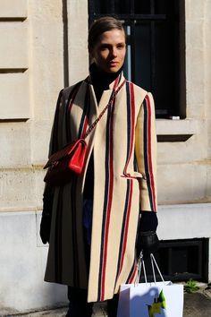 Caroline Brasch Nielsen in a Dries Van Noten coat with a Chanel bag