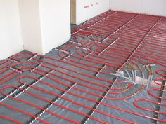 hydronic radiant heating.  it would be so nice to walk on a warm and cozy cork floor with this underneath it.  it's expensive up front, but pays back in about 7 years from the energy savings.