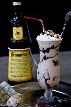 Frangelico Mudslide (2 oz Frangelico hazelnut liqueur 1.5 oz whipped cream vodka 1.5 oz coffee liqueur 1/2 cup vanilla ice cream 1/2 cup coffee ice cream 1 Tbs Nutella 1/4 cup heavy cream)