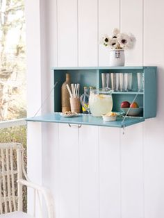 Cupboard turned bar. Love this idea for storage in the mobile boutique.