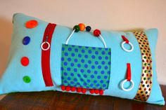 Light blue activity pillow from Memory Lane Sewing.  Provides tactile stimulation for those in mid to late stages of Alzheimer's or other dementia.