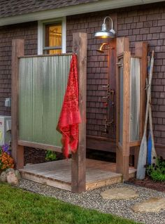 I love this outdoor shower! What a joy it would be to take a shower under the stairs on a hot summer night.