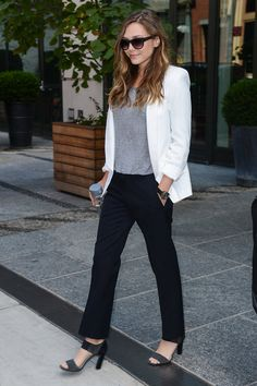 Elizabeth Olsen: Elizabeth Olsen stayed impossibly chic in a white blazer and black pants — proof that easy does it.