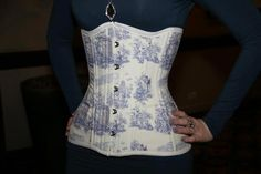 Here's a closeup of the corset Phoenix wore to Gallifrey One! Note the TARDIS, Dalek, Weeping Angel, and Gallifreyan... by Castle Corsetry of course! http://www.facebook.com/castlecorsetry    photo by Alex Halycon    #corset #doctorwho #geek #fashion #sexy #tardis #weepingangels