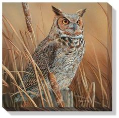 This canvas features a Great Horned Owl perched on an old stump in cattails. This breathtaking wildlife wrapped canvas print is sure to liven up any wall. The wrapped canvas design gives a unique and