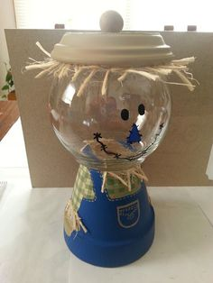 Cute Halloween/Fall Scarecrow Candy Dish. Could use two clear bows and make a snowman