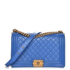 02771a8085d469 This is an authentic CHANEL Lambskin Quilted New Medium Boy Flap in Blue.  This chic
