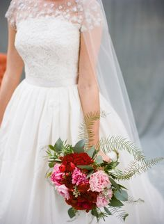 Eucalyptus and ferns added an edgy twist to a feminine peony and ranunculus bouquet by Lotus Flower in Charleston.