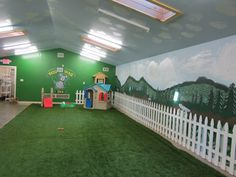Cute indoor play yard. I'd get rid of that fence though, that'd be a wicked pain to clean around.