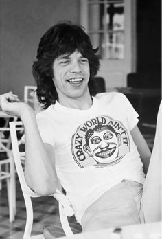 Mick Jagger wears a graphic t-shirt and shorts