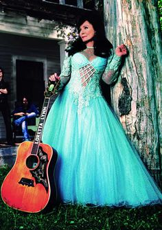 """Loretta Lynn was born in Butcher Holler, Kentucky, the second child of Clara and Ted Webb's eight children. She went on to be a Grand ole Opry favorite and a country music legend with her hit song """"Coal Miner's Daughter."""""""