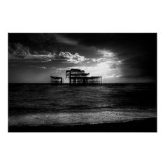 Twisted Metal :- A seriously moody, dark and foreboding image of the remains of Brighton's Victorian West Pier (built 1866) on the south coast of England. The weather front was moving in fast from the West and shrouding the light as it advanced. The sun was hidden by cloud but was managing to put up a fight and broke through long enough to create a dynamic background for the pier's iron frame. #pier #ruin #decay #relic #iron #metal #iconic #brighton #sea #seaside #beach #moody #brooding #hea...