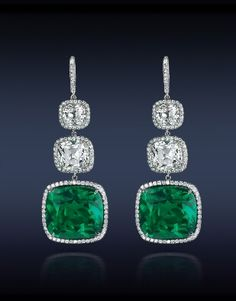 Jacob & Co. | Timepieces | Fine Jewelry | Engagement Rings....An Elegant Emerald Cushion Cut Drop Earrings Featuring: Gubelin CD Certified 27.72 Ct. Cushion Cut Colombian Emeralds (2 Stones) Surmounted by GIA Certified 8.10 Ct. Cushion Cut Diamonds (4 Stones) Highlighted With Pave' Set White Diamonds. Mounted In Platinum.