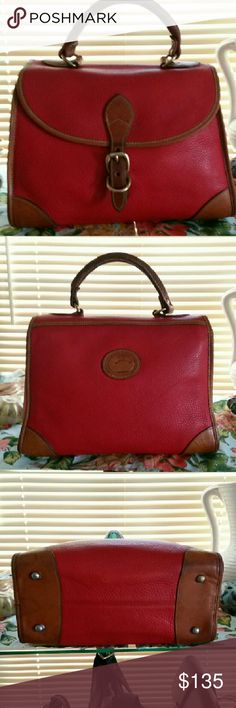 *SALE$85*DOONEY & BOURKE VTG 1980's CARPET BAG Red Carpet Bag pre tag era/ with fob,from the 80's before red/wht/blue tags implemented. In good vtg cond. Her Bottom has one small water stain on left on british tan and one spot in middle of bottom on red leather, . Piping all intact but does have front piping out of shape  from age(rippling )deep patina on handles and trim. Minor scuffs This model was made to not have a shoulder strap .Your purchasing a vintage bag, expect normal wear/ tear…