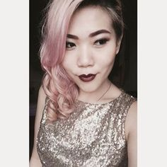 @Delfinadel looks so #elegant with #porcelainskin, pale #rosegold #hair, and a #champagne sequin top. This #lovely lady used #ManicPanic's semi-permanent #haircolor in #CottonCandyPink to tint her pre-bleached locks. Her dark, contrasting #lip is the perfect way to add a little bit of #edginess to her otherwise soft appearance. For a warm shade of #merlot like this, use our #LethalLipstick in #DaughterOfDarkness.