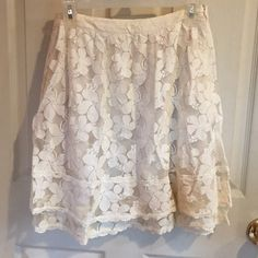 """Cream Lace Skirt By Comme Toi. Cute tiered lace skirt. Cotton/nylon with a polyester lining. Side zip. Waist is about 15"""" flat and length is about 20"""". Has side pockets. Gently worn. ModCloth Skirts"""
