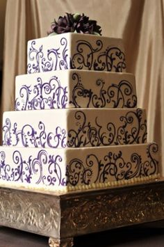 White wedding cakes with purple accents / Milwaukee  Simma's Bakery