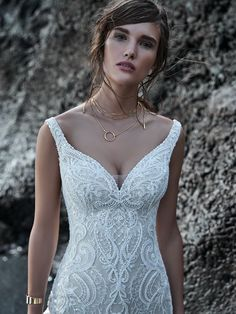 Elias, by Sottero Midgley, is for your true-blue, unabashedly feminine, and sensual soul. This beaded lace mermaid wedding dress delights with delicate off-the-shoulder sleeves, shimmery motifs, and gorgeous illusion details.Atlas Bridal Shop is a bridal & wedding dress shop in Toledo, Ohio. Dress designers include Morilee, Allure Bridal, Allure Couture, Maggie Sottero, Rebecca Ingram, Sottero Midgely, Jade, Jade Couture, Cameron Blake, Montage, MGNY and more. Colored Wedding Dresses, Dream Wedding Dresses, Designer Wedding Dresses, Bridal Dresses, Wedding Gowns, Lace Wedding, Sottero And Midgley Wedding Dresses, Sottero Midgley, Nude Gown