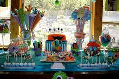 love displaying the monster cake on a pretty box monster birthday party ideas