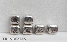 """Pandora retired charms.  Chinese symbols for: 1. friendship nr. 790195. 2. happiness nr. 790194.  3. eternity nr. 790190. 4. harmony nr. 790192.  5. I do not have """"love"""" 6. And the last one"""