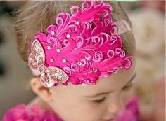 Beautiful vintage style baby headband with hot pink feathers and pink rhinestone butterfly.