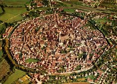 Nördlingen, a city on the Romantic Road in Southern Germany is still bound by its old city wall.  The boundary is the rim of a meteorite crater!  Photo from a postcard scanned by roger4336, via Flickr.