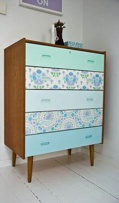 Wallpaper the front drawers of damaged vintage furniture