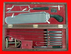 Max Wocher. Amputation Set in Rosewood Case. Amputation Knives, an unusual Capital Amputation Saw, all with Ebony Handles, and a Petit Tourniquet. Made in Cincinnati, Ohio. Circa 1855.