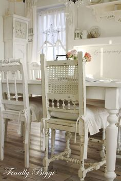 wonderful mis-matched painted chairs love love love these.....so detailed but flows with all the same white color...