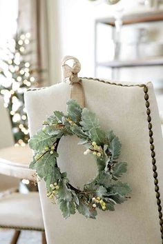 Hang wreaths on the back of dining room chairs