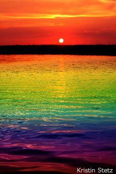 arco-íris refletido no oceano