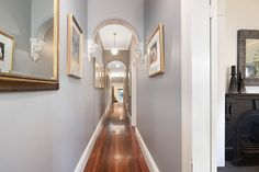 High ceilings, polished floorboards, wall art, hallway, wide entry, classic home with designer interiors, 16 Mayes Street, Annandale, Pilcher Residential