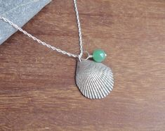 Silver shell necklace with bead charm by MeltSilver on Etsy