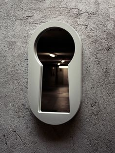The keyhole-shaped Voyeur Mirror by Italian design studio BBMDS. This mirror is a must have!