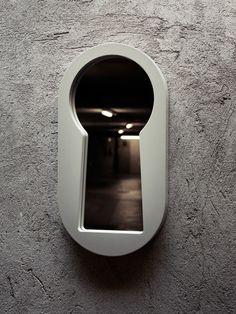 The keyhole-shaped Voyeur Mirror by Italian design studio BBMDS.
