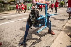 """Picture of a masked """"blue devil"""" character during the Carnival of Trinidad"""
