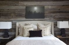 Bedroom with Rustic Gray Plank Walls, upholstered headboard and neutral linens - Ronnie Dunn's Barn Guesthouse designed by Rachel Halvorson