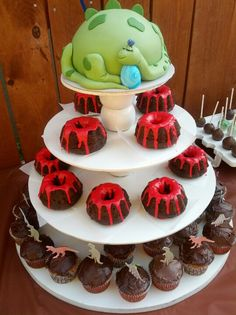 Dinosaur theme baby shower- dino  mom cake & molten lava cupcakes..... https://www.facebook.com/bewilderbugspage https://twitter.com/BewilderBugs https://plus.google.com/u/0/b/108070750963268379060/108070750963268379060/posts https://www.youtube.com/user/BewilderBugs