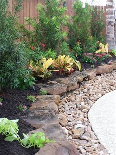 might need to copy the small rocks idea to keep mulch from rinsing off onto brick pathway