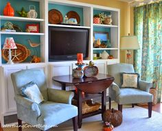 After a complete makeover this one bedroom beach condo in North Carolina got decked out for Fall. The color orange abounds in the living room and out on the porch. Read moreA Blue & Orange Decorated Beach Condo is Decked out for Fall Cozy Home Decorating, Interior Decorating, Decorating Ideas, Decor Ideas, Room Ideas, Beach Condo Decor, Beach Living Room, Living Rooms, Country Interior Design